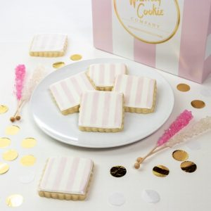 Add a set of our Signature Pink and White cookies to your order