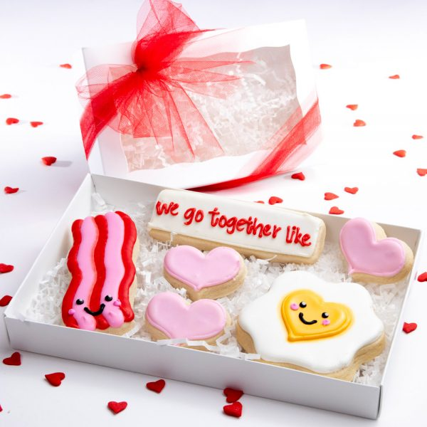 Made with our incredible thick soft and yummy sugar cookie recipe, each cookie is heat sealed, placed in a white window box and tied with ribbon.
